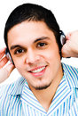 Latin American Man Listening To Headphones Royalty Free Stock Photo
