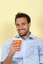 Latin man drinking coffee attractive hot and looking at camera Stock Images