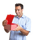 Latin man gets a nice surprise as christmas gift is happy about the Royalty Free Stock Photos
