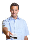 Latin man hands over a newspaper handsome showing on white background Royalty Free Stock Photos