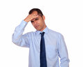 Latin man with headache holding his forehead portrait of a against white background Royalty Free Stock Image