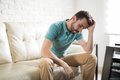 Attractive man worried and alone at home Royalty Free Stock Photo