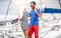 Latin man inviting sexy blonde woman on his yacht Royalty Free Stock Image
