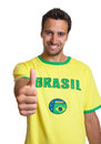 Latin man loves brazil friendly and football Stock Photos