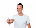 Latin man pointing with remote control Royalty Free Stock Photo
