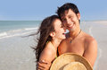 Latin man and woman on beach medium shot of young laughing florida Stock Image