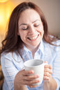 Latin woman drinking coffee Stock Image