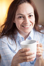 Latin woman drinking coffee Royalty Free Stock Photo