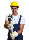 Latin worker using his sledgehammer smiling construction with a on a white background Stock Photos