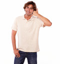Latin young man gesturing call me sign portrait of a with fingers on white backgroud Stock Photography