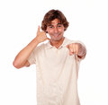 Latin young man gesturing call me sign portrait of a while is pointing at you on white background Stock Image