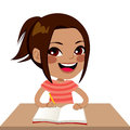 Latina student girl writing cute little smiling happy sitting on desk Stock Image