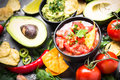 Latinamerican food party sauce guacamole, salsa, chips and ingre Royalty Free Stock Photo