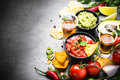 Latinamerican food party sauce guacamole, salsa, chips and tequi Royalty Free Stock Photo