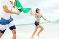 Latino brasil couple hispanic are fans and hold flag having fun together Royalty Free Stock Photos