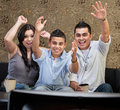 Latino family celebrating of three in front of television Royalty Free Stock Images