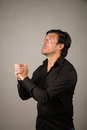 Latino male praying Royalty Free Stock Photo