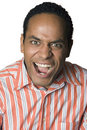 Latino man portrait yelling Royalty Free Stock Photography