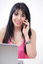 Latino woman phoning Royalty Free Stock Images