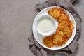 Latkes with sour cream Royalty Free Stock Photo
