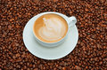 Latte art coffee coffee beans background Royalty Free Stock Photo