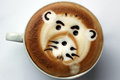 Latte art drawing on coffee drawn by a bear Stock Photography