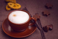 Latte coffee cup and chocolates Stock Image