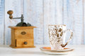 Latte coffee cup with nostalgic coffee grinder on background old wood fence Stock Image