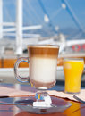 Latte coffee and orange juice Stock Image