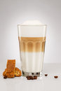 Latte macchiato with coffee beans and cookies cantuccini on gray background Stock Images