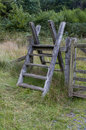 Latter stile style steps up and over fence ladder snowdonia national park gwynedd wales united kingdom Royalty Free Stock Photo