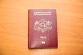Latvian citizen s passport on the table of red color Royalty Free Stock Photos