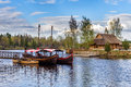 Latvian wooden sailing boats near small pier at Liepkalni town, Latvia Royalty Free Stock Photo