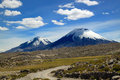 Lauca national park chile scenic view of volcanic group payachata volcanic group at is located in s far Royalty Free Stock Images