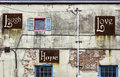 Laugh love hope an old tenement facade with and Stock Image