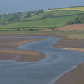 Laugharne taf estuary wales view the tidal and fields and houses in the background Stock Photos