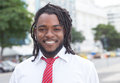 Laughing african american businessman with dreadlocks in the city Royalty Free Stock Photo