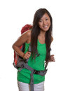Laughing asian backpacker from asia is ready for the trip around the world Royalty Free Stock Photos