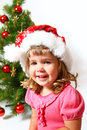 Laughing baby near Christmas tree  Royalty Free Stock Photo