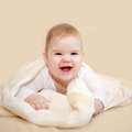 Laughing baby wrapped in towel after bath Royalty Free Stock Photo