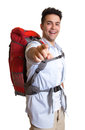 Laughing backpacker pointing at camera Stock Photography