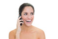 Laughing bare brunette phoning on white background Stock Photography