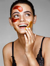 Laughing beautiful girl with color patches on her face. Royalty Free Stock Photo