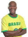 Laughing brazilian football fan soccer is ready for the world cup Stock Photos