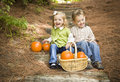 Laughing Brother and Sister Children Sitting on Wood Steps with Pumpkins Royalty Free Stock Photos