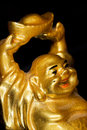 Laughing buddha close up macro shot of the golden statue Royalty Free Stock Photo