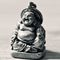 A laughing buddha in duotone closeup of fat Royalty Free Stock Image