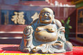 Laughing buddha statue Stock Photography