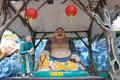 The Laughing Buddha statue at Haw Par Villa in Singapore. Royalty Free Stock Photo