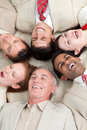 Laughing Business team lying in a circle Royalty Free Stock Photo